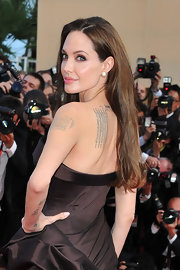Angelina Jolie kept her mane sleek and simple at the Cannes Film Festival with a side parted straight hairstyle.