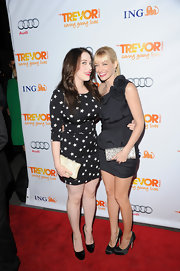 Beth Behrs added shine to her LBD with a glittery silver clutch at the Trevor Live event.