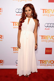 Nicole Polizzi wore a Grecian-style white gown with a belted waist for her red carpet look at the TrevorLIST Event in NYC.