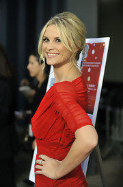 Bonnie Somerville showed off her elegant French twist which she paired with a sheer red dress.