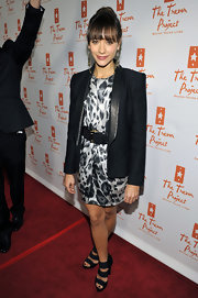 Rashida Jones added interest to her belted mini dress with strappy black heels.