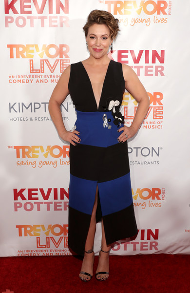 Alyssa Milano made a chic appearance at TrevorLIVE New York in a Gauri & Nainika wrap dress with a plunging neckline and a boldly striped skirt.