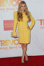 Fergie sported a strong silhouette in a long-sleeve yellow Emanuel Ungaro dress with square buttons during TrevorLIVE.