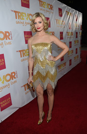 Beth Behrs brought some flapper glamour to the TrevorLIVE LA event with this fringed, beaded gold and silver dress by Naeem Khan.