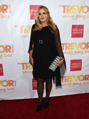 Jennifer Coolidge looked dramatic at the TrevorLIVE LA event in a little black dress with a sheer cape.