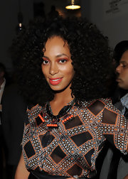Solange Knowles swept on lots of vivid orange eyeshadow with a shimmery pearl finish for the 2012 Tribeca Ball.