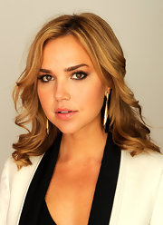 Arielle Kebbel wore her hair in long layered waves for a studio portrait at the 2012 Tribeca Film Festival.