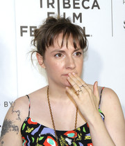 Lena Dunham attended the Tribeca Film Fest premiere of 'Tokyo Project' sporting a just-got-out-of-bed hairstyle!