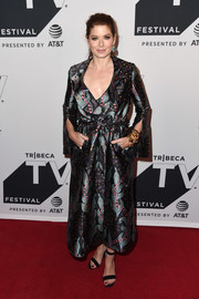 Debra Messing looked sophisticated in a printed coat by Ingie Paris at the Tribeca TV Festival celebration for 'Will & Grace.'