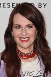 Megan Mullally accessorized with layers of beaded necklaces.