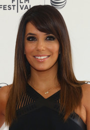 Eva Longoria contrasted her heavy eye makeup with a subtle, shiny lip.