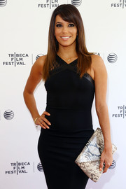 Eva Longoria paired a snakeskin envelope clutch with a modern-chic LBD for the Tribeca Film Festival.