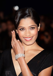 Freida Pinto attended the London premiere of 'Trishna' wearing an exquisite 60-carat diamond cuff bracelet set in platinum.