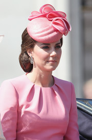 Kate Middleton accessorized with a pink Jane Taylor hat to match her dress.