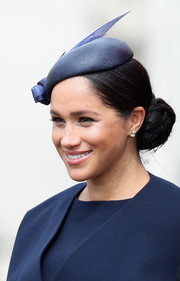 Meghan Markle adorned her lobes with a pair of classic emerald-cut diamond studs.