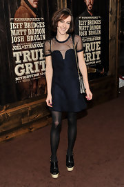 Jena Malone looked adorable in black cutout boots with cream platforms. She the ankle boots with a sweet LBD and voluminous bob.