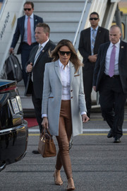 Melania Trump finished off her ensemble with a brown Hermes Birkin.
