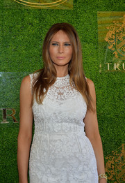Melania Trump styled her LWD with a gold link bracelet when she attended the Trump Invitational Grand Prix.