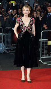 Cate Blanchett polished off her look with elegant gold evening pumps.