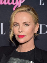 Charlize Theron made her beauty look pop with a swipe of radiant red lipstick.