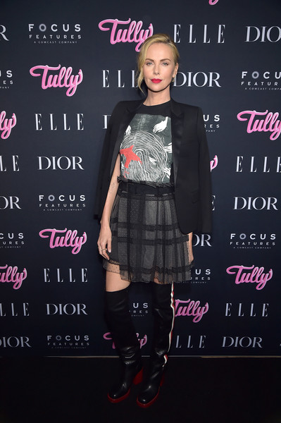 Charlize Theron dressed up her shirt with a mini skirt and a tux jacket, also by Dior.
