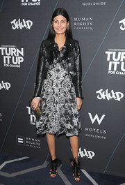 Giovanna Battaglia donned a black-and-white lace cocktail dress, toughened up with a cropped leather jacket, for the Turn it Up for Change Ball.