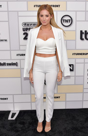 Ashley Tisdale completed her androgy-sexy ensemble with a pair of white slacks, also by Lovers and Friends.