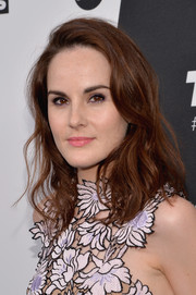 Michelle Dockery looked very girly with her shoulder-length waves at the Turner Upfront.