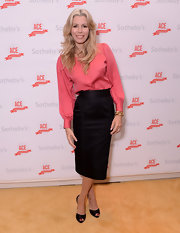 Aviva Drescher made a great pair of a peach button down shirt and a classic banded pencil skirt during ACE's 20th Anniversary Gala.