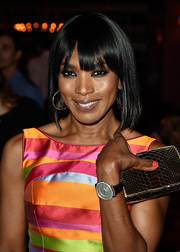 Angela Basset kept it sleek and chic with this shoulder-length, straight 'do with eye-grazing bangs at the Comic-Con cocktail party.