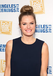 Maggie Lawson chose a high top knot for her casual and chic look.