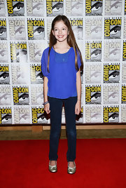 Mackenzie Foys loose blue blouse was an on trend color in a flattering shape.