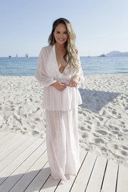 Chrissy Teigen was casual and sexy in a plunging white tunic during Twitter's #HereWeAre at Cannes Lions.