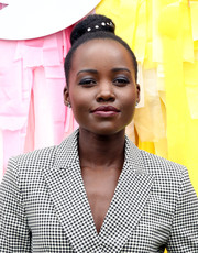 Lupita Nyong'o wore her hair in a studded bun at Twitter's #SheInspiresMe brunch.