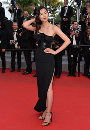 Liu Wen was all about sexy glamour at the 'Two Days, One Night' Cannes premiere in an Yves Saint Laurent strapless column dress with a ruffled bustline and a dangerously high slit.