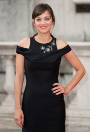 Metallic green nail polish provided a fun finish to Marion Cotillard's LBD at the 'Two Days, One Night' premiere.