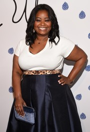 Octavia Spencer accessorized with an elegant blue velvet clutch at the Tyler Ellis 5th anniversary celebration.