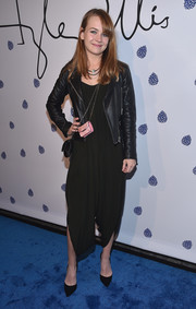 Britt Robertson toughened up her outfit with a black leather moto jacket.