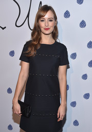 Ahna O'Reilly paired a satin envelope clutch with studded LBD for the Tyler Ellis 5th anniversary celebration.