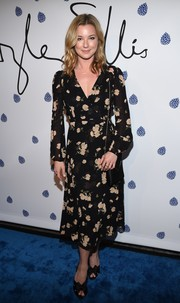 Emily VanCamp teamed her dress with bow-adorned peep-toe pumps.