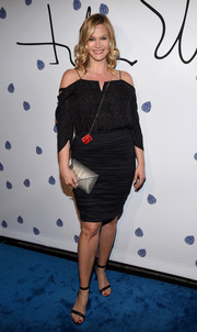 Natasha Henstridge completed her outfit with a pair of black ankle-strap sandals.