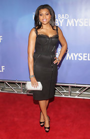 This chunky diamond encrusted bracelet works well with Taraji's hoop earrings and gives her a serious glam factor.