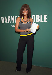 Model and best-selling author Tyra Banks promoted her new book while wearing her hair in a medium cut with front bangs.