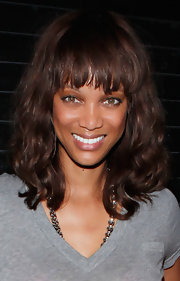 Tyra Banks visited Cirque du Soleil 'Zarkana' rocking a wavy, shoulder length bob. Her not-quite-blunt bangs emphasized her beautiful eyes.