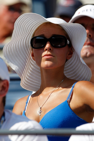 Jelena blocked out the harmful UV rays in a floppy white straw hat.