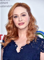 Christina Hendricks attended the Innovators for a Healthy Planet event looking lovely with her half-pinned waves.