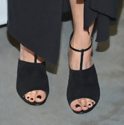 Courteney Cox was black from head to toe as she donned these black strappy sandal that even revealed a black pedicure.