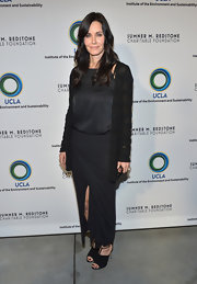 Courtney Cox looked boho-chic with an oversized cardigan paired with a loose blouse and long skirt.