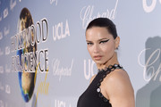 Adriana Lima attended the 2019 Hollywood for Science Gala wearing her hair in a croydon facelift.