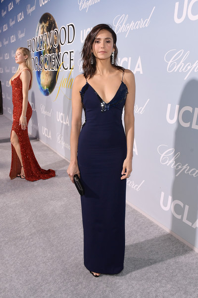 Nina Dobrev looked sultry in a figure-hugging midnight-blue slip gown by Cushnie at the 2019 Hollywood for Science Gala.